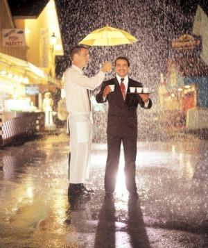 Chris Shake holds an umbrella