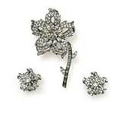 Diamond brooch and earrings on display