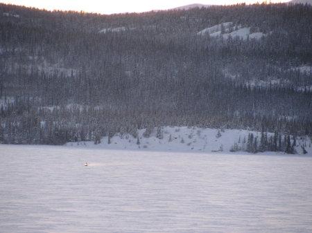 Lone snowmobiler crosses Marsh Lake