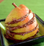 Poached pear encircled by Nutella