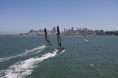 Oracle Team AC45 boats streaking toward San Francisco