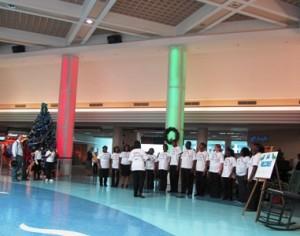 High school chorus serenades holiday travelers