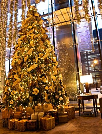 Trump International Hotel and Tower's holiday decorations lean toward the traditional but the gleaming structure and its rooms are high end contemporary
