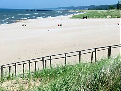Relax at Saugatuck's Oval Beach before fall activities fill the schedule.